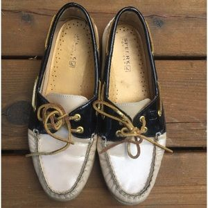 black and pale pink sperrys
